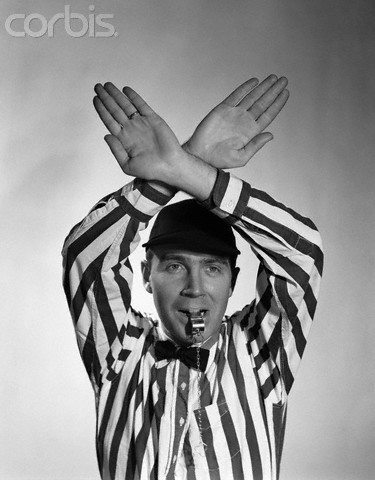 1950s Football Referee Making Hand Signal Time Out Blowing Whistle